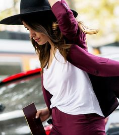 The Latest Street Style Photos From Milan Fashion Week via @WhoWhatWear--- love this plum colored suit