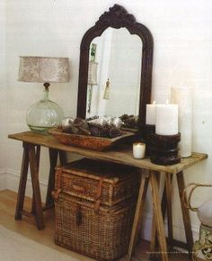 Love the rustic table with simple objects on top, and great baskets beneath!