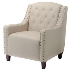 Diamond-tufted club chair with a wood frame and nailhead-trimmed upholstery.  Product: ChairConstruction Material: