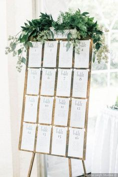 Wedding seating chart - Wooden sign + greenery decor + table cards {Sabrina Leigh Studios} chart wedding ideas Alex and Nicole's Wedding in Traverse City, Michigan Wedding Guest Table, Wedding Table Seating, Guest Book Table, Guest Books, Wedding Signing Table, Wedding Table Signs, Wedding Seating Charts, Wedding Book, Table Seating Chart