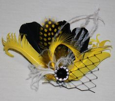 Black Yellow and White Feather Boutique Hair Clip Fascinator Photp Prop. $26.99, via Etsy.