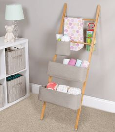 Wren Storage Ladder With Cotton Totes at STORE. Bamboo storage ladder with 3 adjustable soft cotton totes and a storage hook.