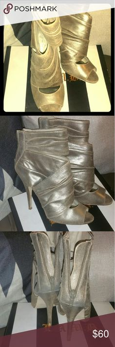 Gold Distressed Ankle Boot Gold Distressed Ankle Boot..leather upper. Man made bottom. Worn twice. Peep toe. The heel shows no wear. Zipper back. Shoe is a size 38. I am listing it as a size 7.5 because it is narrow. 4 inches in height. Please ask any questions. Aldo Shoes Heels