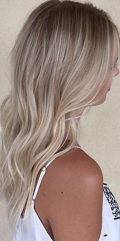 The most subtle, superfine blonde highlights = Babylights. Color by Priscilla Cardenas.