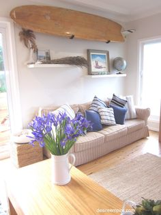 beach living room. Love the wooden surfboard