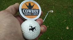 Hole in One with a crazy Bucking Cowboy golf ball and a can of Energized Chewing Tobacco alternative