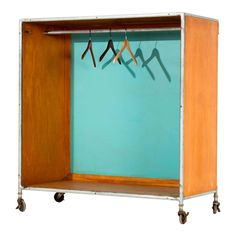 Glass for Fleetwood rolling closet. Features hanging pole with aluminum and wood structure with locking wheels.