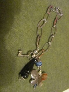 Bracelet with key and butterfly