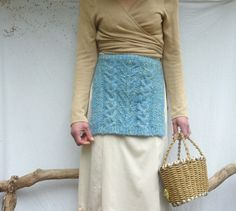 Wilderness Apron, hand knitted in blue mohair-mix fancy yarn