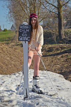 Keep Calm and go Skiing ! Nice girl wearing skis and summer clothes :)