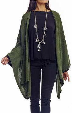 This versatile cashmere poncho may be worn as a scarf or wrap. Asymmetrical hemline.   Fabric:  Cashmere.  Dry clean.