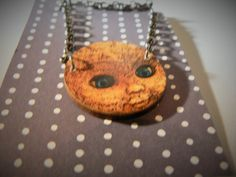SALE doll face kewpie  scary  pop art necklace by SnixySwoons
