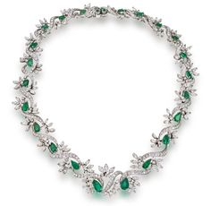 An emerald and diamond necklace  designed as scrolling links of round brilliant-cut diamonds, accentuated with round brilliant and marquise-cut diamonds, further enhanced by pear-shaped emeralds; estimated total diamond weight: 7.10 carats; mounted in platinum; length: 19 1/2in.