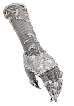 Gauntlet, co-lab by the jewellery whiz Shane Leane and Daphne Guinness    I would have no practical use for this whatsoever, but lord, do I want it.  Just don't wear tights with it. Holy run-in-your-stockings.