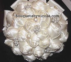 Made to Order Brooch Bouquet Bridal Wedding Flowers Satin Roses Bride Bridesmaids EMR-212. This bouquet is made with satin roses in your choice of colors and wrapped with satin ribbon. It also has the most beautiful pearl brooches and rhinestones as decorations. This bouquet is available in three sizes.