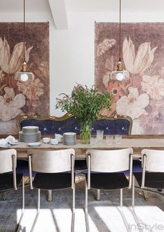 Lea Michele's feminine dining room with low hanging pendant lights, hanging tapestries, and metal dining chairs