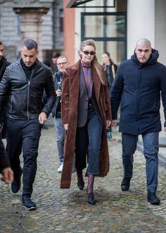 Model Gigi Hadid wearing brown coat cropped denim jeans ankle boots Fendi mini bag seen outside Max Mara during Milan Fashion Week Fall/Winter...