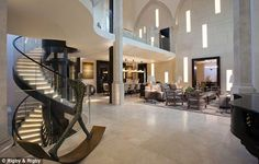 A temple to modern interior design: Former Knightsbridge church converted into £50m luxury home complete with gym, pool and sauna Church was built on a plot of land bought in 1837 for £300 It is now a seven-bedroom home split over four storeys Has a lift made of bronze and glass that is hidden inside spiral staircase Main drawing room is in the nave of the church and has 42ft high ceiling