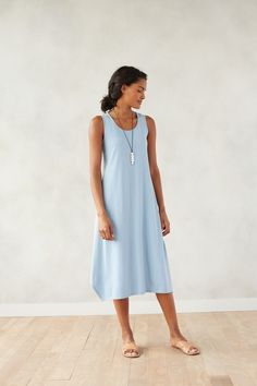 Comfort and ease with our Pure Jill dipped-hem A-line dress accessorized with our Pure Jill calm pendant necklace