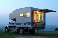 Now that is a cool entry door for a truck camper. Add a couple Travel EASY Decks and you have the perfect covered porch . . . ANYWHERE you want to go!