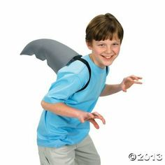 "Polyester Shark Fin Costume Accessory. With 2 elastic straps. (1 pc./PBH) 12"" by NHC. $9.99. Polyester Shark Fin Costume Accessory. With 2 elastic straps. (1 pc./PBH) 12"""