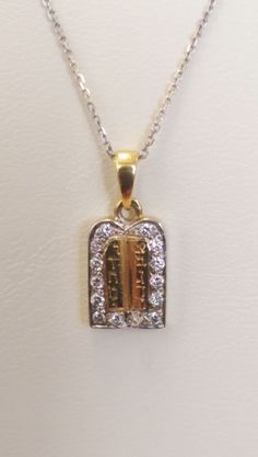 """This pendant is called """"The Torah"""", its meaning is significant in #Judaism. It is considered one of the holiest scriptures in our history. The #pendant has Jewish lettering inscribed giving the pendant more meaning. On the outside of the #Torah there are 15 diamonds totaling .15 carats. Enjoy wearing the holy Torah.   Details : 0.15 ct #Diamonds 14K Yellow Gold 16.51 mm x 6.35 mm  1.42 grams $130"""
