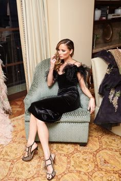 Georgina Chapman Gets Ready for Weinstein Company's Pre-Oscar Bash:As co-founder of Marchesa, pretty much any party-ready poufy dress is as good as hers; and when you factor in her plus-one to these things (Weinstein Company co-chair and producer Harvey Weinstein), chances are you're more or less set for a picture-perfect Oscars weekend. ---- Black velvet dress with feathers. | Coveteur.com
