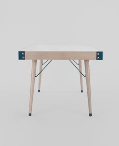 COMMUNAUTÉ - a dining table with oak and powder coated metal frame; Silestone® top.