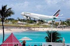 Air France Airbus A340-313 F-GLZJ on the classic Maho Beach final approach to St Maarten-Princess-Juliana, May 2012. (Photo via Flickr: mpmark)