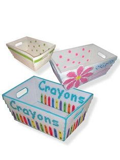"""Now you can organize with plastic canvas!   Organize your crayons, craft tools, sewing needs and much more with these 3 handy baskets that will """"catch all"""" of your materials. All are made using 7-count plastic canvas and worsted-weight yarn. Size: 11"""" x 7"""" x 5""""."""