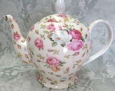 What a GORGEOUS little rose chintz teapot for sale on Ebay.    http://www.ebay.com/itm/Rose-Basket-FINE-BONE-CHINA-ENGLISH-chintz-6-CUP-TEAPOT-Made-England-/221103370667?pt=LH_DefaultDomain_0=item337ac9b1ab
