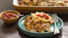 Cheesy enchiladas just got easier in this quick gluten-free casserole. A new go-to dish for your next potluck.