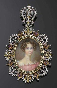 ENAMEL AND GOLD PENDANT WITH PORTRAIT MINIATURE, probably E. FROMENT-MEURICE, Paris. Featuring a very finely painted portrait of Mary Christine of Savoy, Queen of Sicily. Partially black enamelled frame set with 8 emeralds in a pronged setting and surrounded by a wreath of white, black and pink enamel palmetto ornaments alternating with 8 rubies in pronged settings. The back of the portrait engraved: Marie Christine de Savoie Reine des deux Siciles Née le 14. Novembre 1812 † le 31 Janvier…