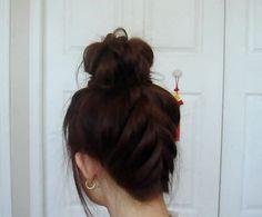 http://blog.flauntme.com/2011/11/06/try-out-a-gyaru-inspired-upside-down-braided-bun/#