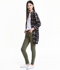 Khaki green. 5-pocket, low-rise jeans in washed superstretch denim with skinny…