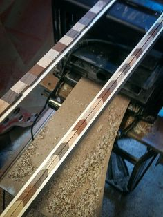 The first 16ft side is now completed except for the midpoint connecting piece. This morning I passed the glued up blocks on pine backing through the thicknesser to make them standard 3/8″ thi…