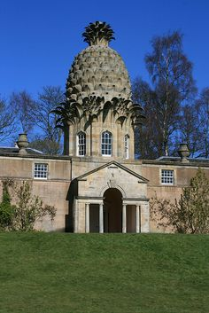 The Dunmore Pineapple is a folly at Dunmore Park in Dunmore, Scotland;  in 1761 the 4th Earl of Dunmore built a hothouse into the wall of a high walled garden - the hothouse was used to grow pineapples and other things;  apartments for gardeners were built on each side;  the stone pineapple is 46 feet tall
