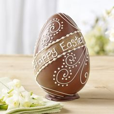 Milk Chocolate Happy Easter Egg | £14.95 | A Swiss milk chocolate egg, hand-piped in white chocolate with out classic fern design and 'Happy Easter' message on a brushed golden background.