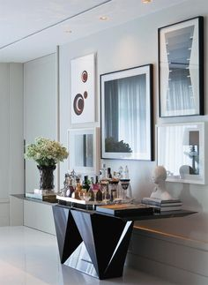 Gallery wall and contemporary console table