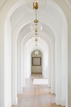 California Traditional Home Tour : Arched hallway with globe pendants lining the hall, abstract artwork, California Traditional Interior Design Interior Design Studio, Modern Interior Design, Home Design Blogs, Foyer Decorating, Interior Decorating, Decorating Ideas, Arch Interior, Interior Colors, Interior Stairs