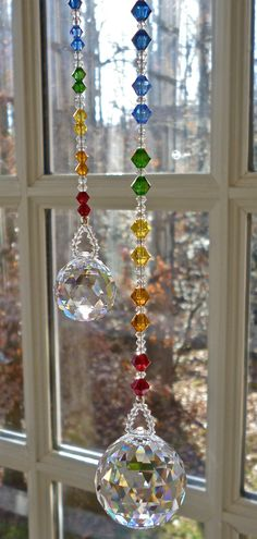 Swarovski Crystal Ball on Chakra Colored Strand, Crystal Sun Catcher, Hanging Crystal, Rainbow Maker Bead Crafts, Diy And Crafts, Arts And Crafts, Suncatchers, Deco Table Noel, Chakra Colors, Diy Wind Chimes, Crystal Wind Chimes, Deco Nature