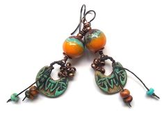 Just listed. I love love the colors! Southwest coloring and Tribal designs. Love it! -- Tribal Rustic Earrings Earthy Ceramics Dangle by SheFliesAgain