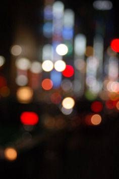 "tokyo Bokeh effect - street lights cause a blurred effect. Bokeh is defined ""the way the lens renders out-of-focus points of light"""