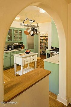 THis kitchen keeps the charm of a 1920s Spanish Revival home. Well done. | Linda Ronstadt's House in Arizona For Sale (9)