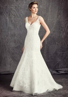 Mermaid silhouette with v-neck neckline and semi-cathedral train | Kenneth Winston: Ella Rosa Collection | https://www.theknot.com/fashion/be292-kenneth-winston-ella-rosa-collection-wedding-dress