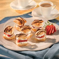 Petit Fours Strawberry Shortcakes...Golden puff pastry is layered with sweet strawberries and whipped cream, and drizzled with melted chocolate to make this delectable dessert. Pepperidge Farm)
