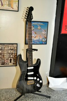 Transparent Black Stratocaster. It could be a Fender Deluxe Players Strat