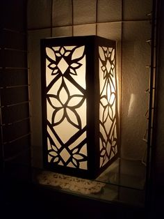 """Making Rivendell in the Desert: Elven Interior Decorating Continued : How to make Elven Lanterns (inspired by """"Moroccan Lamps"""") out of Posterboard, tissue paper, and an electric candle"""