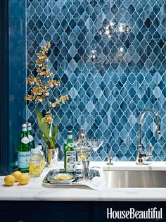 For a bar area in this Greenwich, Connecticut home, designer Ashley Whittaker chose Aladdin tile from Waterworks to conjure up an exotic Moroccan feel.   - HouseBeautiful.com