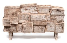 The Birchwood collection by Werner Neumann, features pieces that were covered in birch bark that Neumann found in the forest. Some of the pieces are covered with epoxy and then painted while the other pieces stay rough.